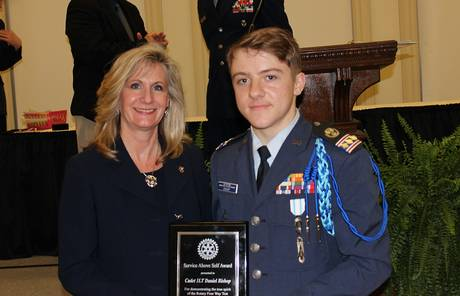 Karen Dixon, president of the Denton Rotary Club, presents the Service above Self Award to Daniel Bishop, a CAP cadet with the Denton Nighthawk Composite Squadron of the Civil Air Patrol.